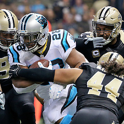 Dec 6, 2015; New Orleans, LA, USA; Carolina Panthers running back Jonathan Stewart (28) is tackled by New Orleans Saints outside linebacker Hau'oli Kikaha (44) and defensive tackle Kevin Williams (93) and defensive end Cameron Jordan (94) during the first quarter of a game at Mercedes-Benz Superdome. Mandatory Credit: Derick E. Hingle-USA TODAY Sports