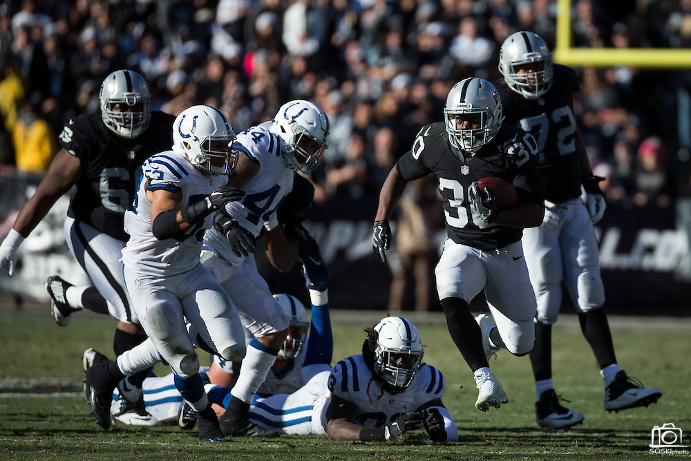 Oakland Raiders defensive back SaQwan Edwards (30) carries the ball against the Indianapolis Colts at Oakland Coliseum in Oakland, Calif., on December 24, 2016. (Stan Olszewski/Special to S.F. Examiner)