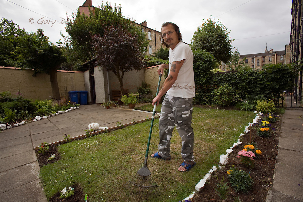 Glasgow Housing Association improvements in Govanhill, Glasgow. Bohumil Triska in his back garden in Boyd Street.