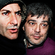 """ITALY, Naples : An Italian policeman escorts Antonio Iovine (R), one of the most powerful leaders of the Camorra organised crime group, following his arrest after 14 years on the run, on November 17, 2010 in Naples. Iovine, believed to be the boss of the murderous Casalesi clan, was nabbed in Casal di Principe, the clan's home town north of Naples. He had been on the interior ministry's most wanted list for years. Iovine was found in a home in Casal di Principe after """"complex"""" police work and he did not resist arrest, a ANSA news agency's report said. AFP PHOTO / ROBERTO SALOMONE"""