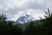 Georgia, Mount Kazbek (5033 M) as seen from the 14th century Gergeti Trinity Church (Tsminda Sameba) Holy Trinity Church near the village of Gergeti
