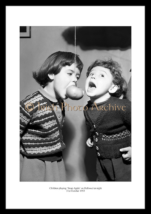 This fantastic shot of two Irish children playing Snap Apple is a great anniversary gift for someone that likes old Irish Photos.