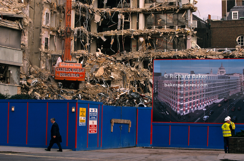 In the heart of the City of London, a caterpillar tracked crane tears down the walls of an old 70s office block close to St Paul's Cathedral, England. As a pedestrian walks past the blue hoardings that protect passers-by like him, the rubble is piled high before being removed as spoil to make way for an brand new construction that appears in an artist's impression picture on the right, above two site engineers wearing fluorescent jackets and hard hats. This is a scene of renewal in London's financial district. Of optimism and regeneration as businesses invest in new workplaces and replacing the tired, old offices that cannot accommodate new computer and server cabling technology.  ..