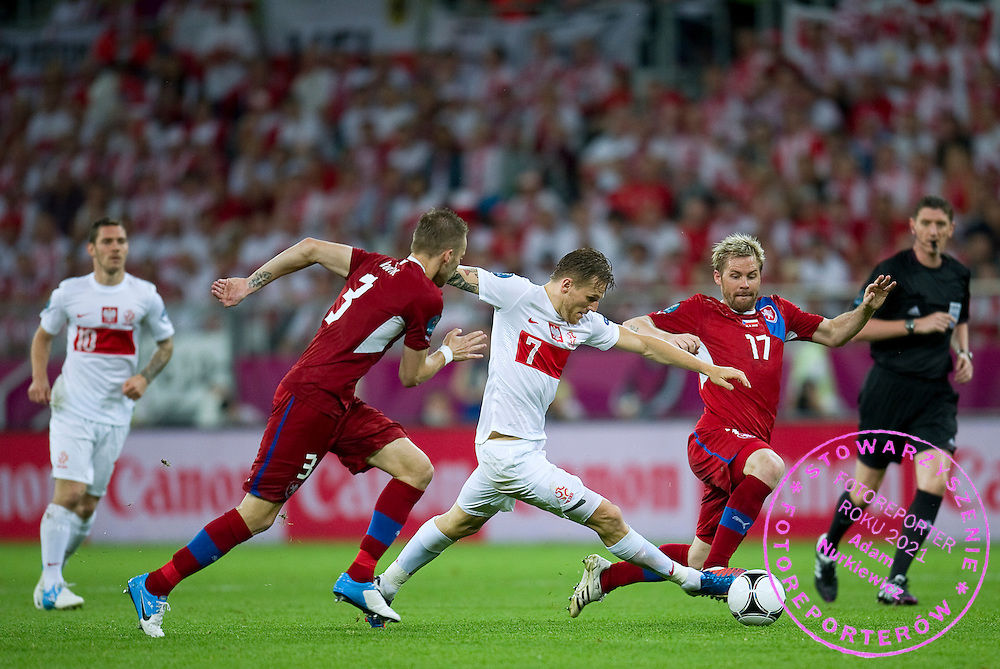 (C) Poland's Eugen Polanski (nr07) controls the ball during the UEFA EURO 2012 Group A football match between Poland and Czech Republic at Municipal Stadium in Wroclaw on June 16, 2012...Poland, Wroclaw, June 16, 2012..Picture also available in RAW (NEF) or TIFF format on special request...For editorial use only. Any commercial or promotional use requires permission...Photo by © Adam Nurkiewicz / Mediasport