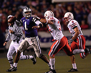 Kansas State quarterback Josh Freeman (1) looks down field against pressure from Nebraska defenders Stewart Bradley (34) and Andrew Shanle (8) in the second half at Bill Snyder Family Stadium in Manhattan, Kansas, October 14, 2006.  The Huskers beat the Wildcats 21-3.<br />