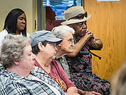 15 JULY 2019 - DES MOINES, IOWA: People listen to Senator Amy Klobuchar (D-MN) during a roundtable about issues related to old Americans. Sen. Klobuchar hosted a roundtable on issues important to older Americans at a community center in Des Moines. Klobuchar is running to be the Democratic candidate for President in the 2020 election. Iowa hosts the first event of the Presidential election cycle. The Iowa Caucuses are on February 3, 2019.          PHOTO BY JACK KURTZ