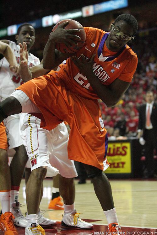 Jan 22, 2011; College Park, MD, USA; Clemson Tigers forward Brian Narcisse (21) pulls in a rebound against the Maryland Terrapins during the first half at the Comcast Center. Mandatory Credit: Brian Schneider-www.ebrianschneider.com