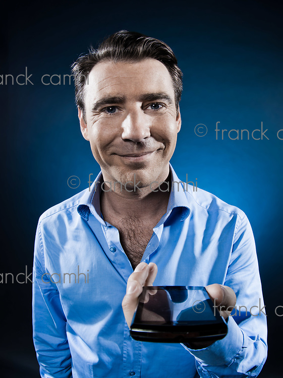 caucasian man give cellphone unshaven portrait isolated studio on black background