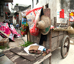 Hand-pulled work cart on a small street near the River Li in Yangshuo.  Humans often do the work of animals and machines even in today's highly industrialized China.