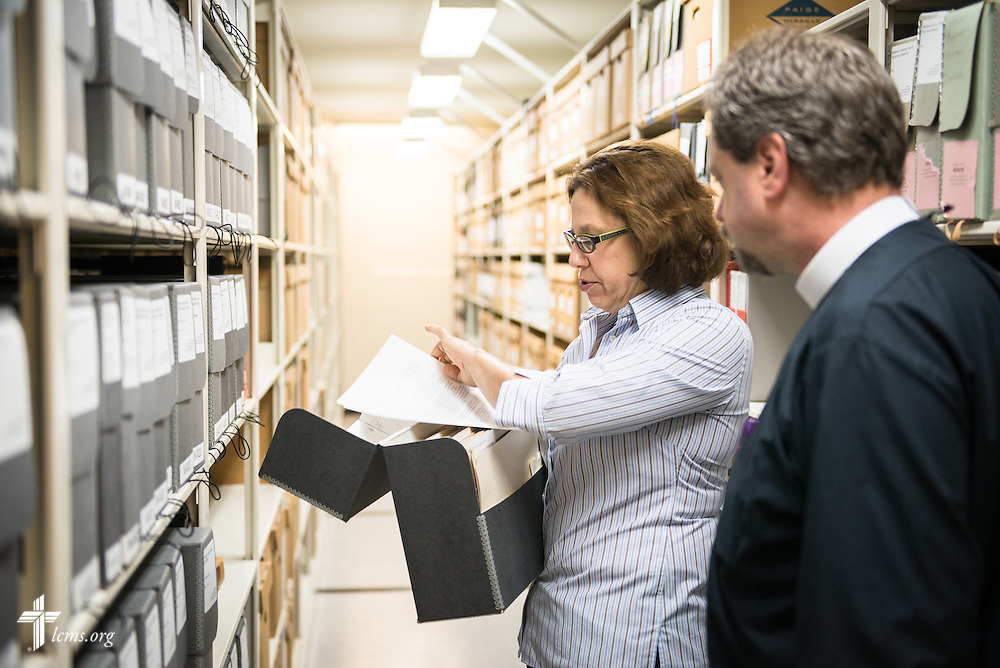 Patrice Russo, executive assistant and museum manager, examines historical documents with the Rev. Dr. Daniel Harmelink, executive director of Concordia Historical Institute (CHI), in the institute's archives on Monday, July 21, 2014, on the campus of Concordia Seminary in Clayton, Mo.  LCMS Communications/Erik M. Lunsford