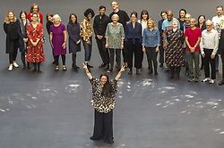 October 1, 2018 - London, UK - LONDON, UK. Tania Bruguera (front) stands with volunteers after leaving body impressions on the heat-sensitive floor. Unveiling of the this year's Hyundai Commission by Cuban artist and activist Tania Bruguera at Tate Modern.  The work is called ''an ever-increasing figure'', which represents the scale of mass migration and the risks involved.  Visitors are invited to interact with the work which comprises a heat-sensitive floor, which includes a portrait of a person's face beneath, combined with low frequency sounds.  The work is on display 2 October to 24 February 2019. (Credit Image: © Stephen Chung/London News Pictures via ZUMA Wire)