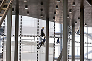 """Roma 22 Dicembre 2015<br /> Presentato lo stato di avanzamento dei lavori del nuovo centro Congressi «La Nuvola» al quartiere EUR, progettato dall'architetto Massimiliano Fuksas.  Operai con le funi al lavoro  nel cantiere.<br /> Rome December 22, 2015<br /> Presented the state of progress of the work of the new congress center """"The Cloud"""", at the EUR district, designed by architect Massimiliano Fuksas.  Workers with ropes at work in construction site."""