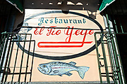 Sign advertising the famous El Tio Yeyo restaurant known for local trout dishes in the central historic district of Coatepec, Veracruz State, Mexico.