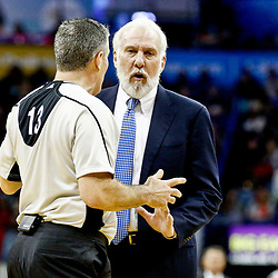 Mar 3, 2017; New Orleans, LA, USA; San Antonio Spurs head coach Gregg Popovich argues a call with referee Monty McCutchen (13) during the second half of a game against the New Orleans Pelicans at the Smoothie King Center. The Spurs defeated the Pelicans 101-98 in overtime. Mandatory Credit: Derick E. Hingle-USA TODAY Sports