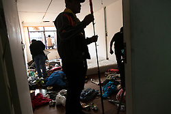 © Licensed to London News Pictures. 17/01/2014. Anti-Government protestors inside the room that was housing the suspect whom threw an explosive device injuring eight people during an anti-government street rally on January 17, 2014 in Bangkok, Thailand. Anti-government protesters launch 'Bangkok Shutdown', blocking major intersections in the heart of the capital, as part of their bid to oust the government of Prime Minister Yingluck Shinawatra ahead of elections scheduled to take place on February 2. Photo credit : Asanka Brendon Ratnayake/LNP