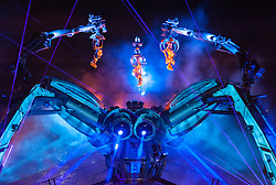 "© Licensed to London News Pictures. 05/09/2015. Bristol, UK.  Arcadia's Metamorphosis show in Bristol's historic Queen Square, as the city hosted the world's first recycled biofuel pyrotechnics show. The 50-tonne Arcadia spider, made from used repurposed military hardware and fuelled by waste oil from local fish and chip shops, landed in the city this weekend to celebrate its year as European Green Capital 2015. Arcadia's founders, Pip Rush and Bert Cole explain; ""We're hugely honoured to play a part in Bristol's year as Green Capital and have been overwhelmed by the excitement around the city. We're proud to be a part of Bristol's vibrant community and hope that by performing a new show amidst a dynamic mechanical sculpture that is built and powered by re-used resources, we can share a weekend of collective joy with thousands in the heart of the city."" Zoe Sear, Bristol 2015, added: ""We are excited that Bristol will host the world's first pyrotechnics show fuelled entirely by recycled biofuel – this is a seminal moment for the city. The iconic spider is not only made from 'waste' materials, but now its flames will be powered by waste oil collected from Bristol's chip shops, which is a brilliant example of how our resources can be re-used. With the theme of the Metamorphosis show focused on transformation and change, it is bringing the ethos of sustainability to life."" Metamorphosis, which was unveiled at Glastonbury Festival in June, took place in Bristol on 4 and 5 September. The show - Arcadia's first ever inner city event – saw the spider come alive as a living organism, fusing sustainable ideas and technologies with art, music and performance, to create a spectacular symphony of transformation. It was part-funded by Arts Council England under its Exceptional Awards Scheme as part of Bristol's year in the spotlight as the UK's first European Green Capital. Photo credit: Simon Chapman/LNP"