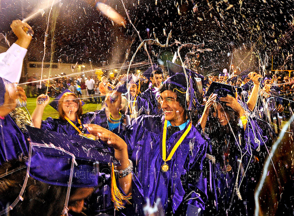 Live Oak High Class of 2013 graduates spray silly string over one another following the school's graduation ceremony in Live Oak on Wednesday, June 5, 2013. (Nate Chute/Appeal-Democrat)