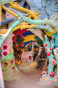 Salvation Mountain, small hill, three stories high, covered in acrylic paint, by Leonard Knight.