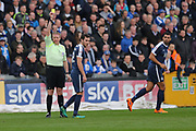 Southend United Will Atkinson (12) picks up a yellow card from Referee Trevor Kettle first half during the EFL Sky Bet League 1 match between Bristol Rovers and Southend United at the Memorial Stadium, Bristol, England on 11 March 2017. Photo by Gary Learmonth.