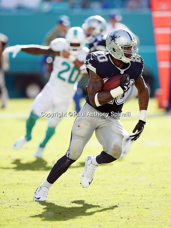 Dallas Cowboys running back Darren McFadden (20) runs for a third quarter first down during the 2015 week 11 regular season NFL football game against the Miami Dolphins on Sunday, Nov. 22, 2015 in Miami Gardens, Fla. The Cowboys won the game 24-14. (©Paul Anthony Spinelli)