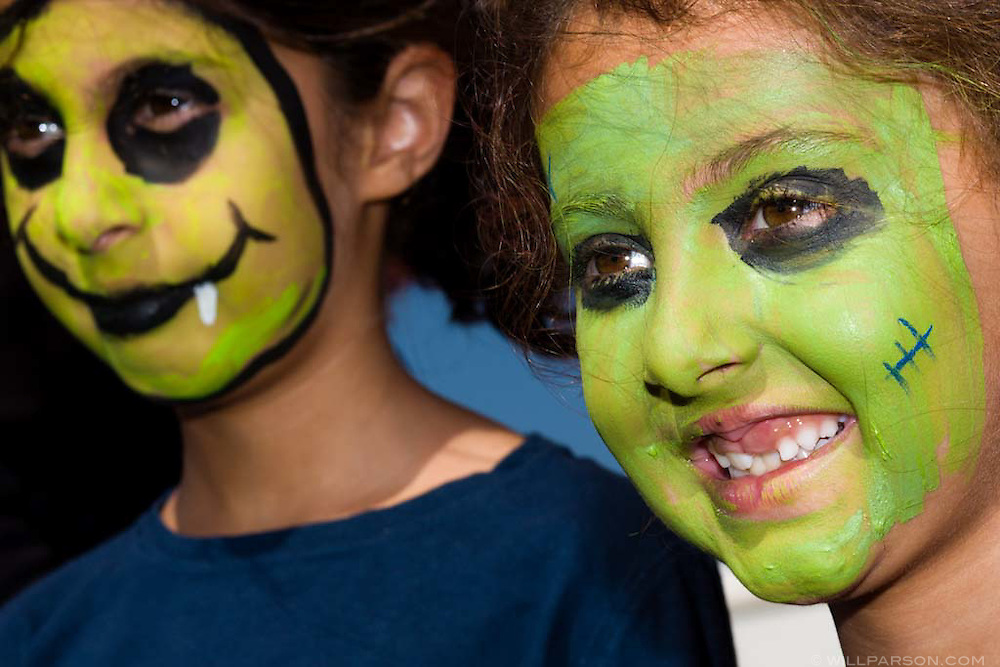 Soha Shahidi (left, age 9), and her sister Eilee (age 7) show off their freshly painted faces  during the Halloween carnival at the Ashley Falls School in Carmel Valley on October 19, 2008.