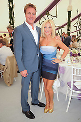 HENRY BECKWITH and GERI HALLIWELL at the Cartier International Polo at Guards Polo Club, Windsor Great Park, Berkshire on 25th July 2010.