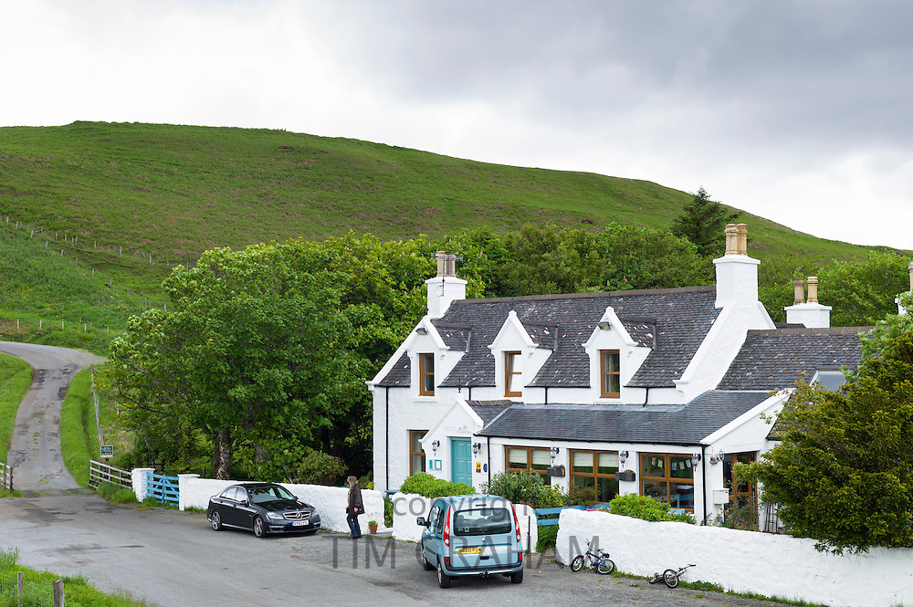 Tourist at traditional Scottish Glenview Hotel at Cul Nan Cnoc on Isle of Skye, the Western Isles of Scotland, UK
