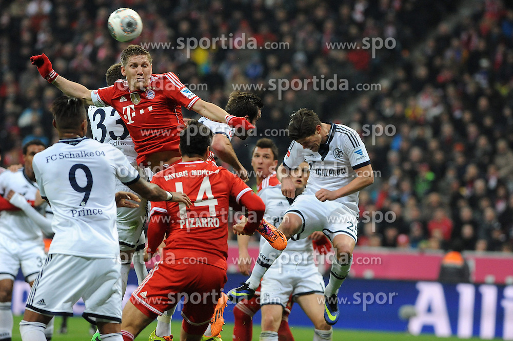 01.03.2014, Allianz Arena, Muenchen, GER, 1. FBL, FC Bayern Muenchen vs Schalke 04, 23. Runde, im Bild Bastian Schweinsteiger (FC Bayern Muenchen) springt am Hoechsten Rechts klaert Klaas-Jan Huntelaar (Schalke 04) // during the German Bundesliga 23th round match between FC Bayern Munich and Schalke 04 at the Allianz Arena in Muenchen, Germany on 2014/03/01. EXPA Pictures &copy; 2014, PhotoCredit: EXPA/ Eibner-Pressefoto/ Stuetzle<br /> <br /> *****ATTENTION - OUT of GER*****