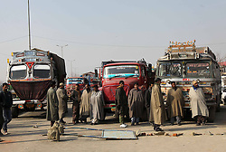 Drivers wait to restore vehicular traffic on a national highway during a protest against unscheduled power cuts on the outskirts of Srinagar, summer capital of Indian-controlled Kashmir, Jan. 8, 2013. Locals said that only three hours of power supply was provided daily for the past several weeks, which led to the worsening of the living condition in the cold weather, January 8, 2013. Photo by Imago / i-Images...UK ONLY