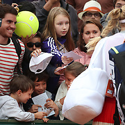 2017 French Open Tennis Tournament - Day Seven.  A young fans shows his delight at getting the autograph of Caroline Wozniacki of Denmark after her win against Catherine Bellis of the United States during the Women's Singles round three match on court two at the 2017 French Open Tennis Tournament at Roland Garros on June 3rd, 2017 in Paris, France.  (Photo by Tim Clayton/Corbis via Getty Images)