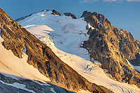 Peaks of Boulder/Salal Divide glowing in evening light, Coast Range British Columbia Canada