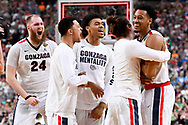 GLENDALE, AZ - APRIL 01:  Johnathan Williams #3 (right), Przemek Karnowski #24 of the Gonzaga Bulldogs, and teammates react after the final play during the 2017 NCAA Men's Final Four Semifinal against the South Carolina Gamecocks at University of Phoenix Stadium on April 1, 2017 in Glendale, Arizona.  (Photo by Brett Wilhelm/NCAA Photos via Getty Images) *** Local Caption *** Johnathan Williams; Przemek Karnowski