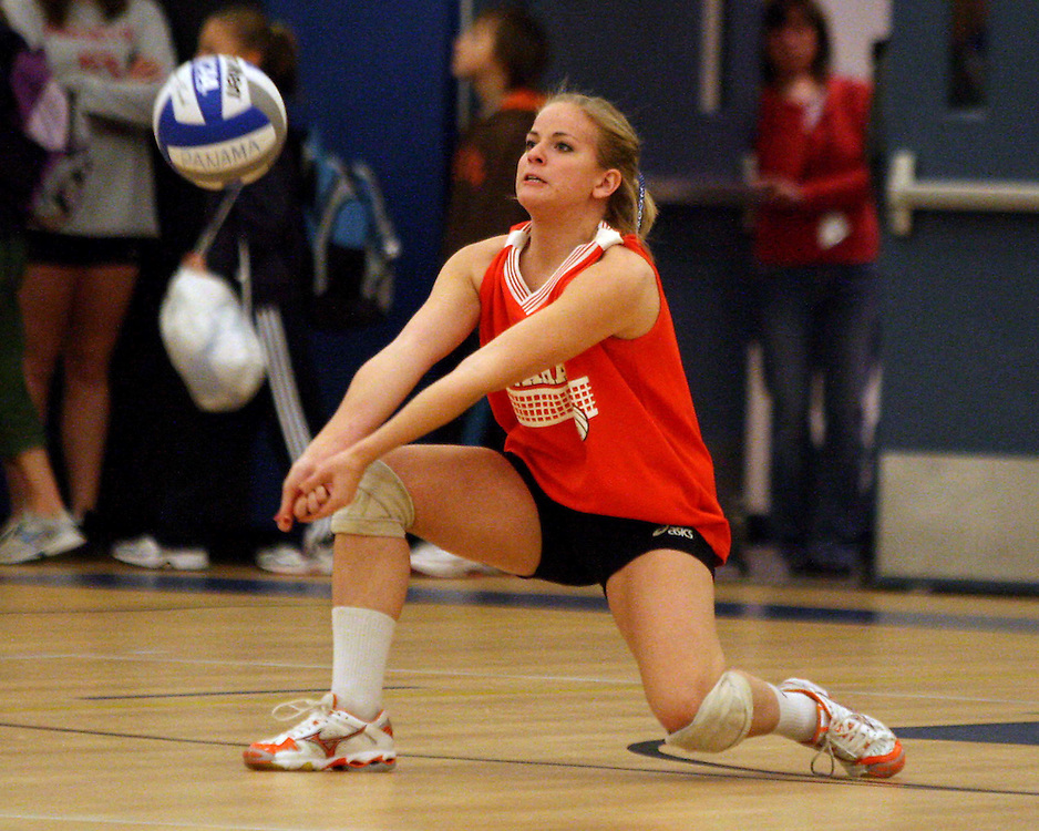 Panama's Randi Bilinski gets low to dig a serve against Maple Grove during volleyball action 10-15 photo by Mark L. Anderson