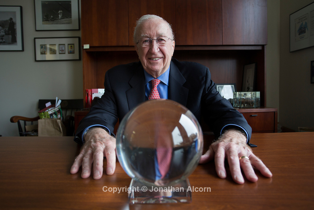 January 7, 2014 Westlake Village, CA   Dave Powers, founder of J.D. Power and Associates, poses for a portrait in his office with a crystal ball that sits on his desk and jokingly used to make his automotive business predictions. <br /> photo by Jonathan Alcorn for The Boston Globe
