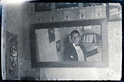 young adult man looking at him self in the mirror  France ca 1920s