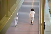 Nederland, Nijmegen, 14-1-2013Verpleegkundige rent door een gang van het ziekenhuis.Foto: Flip Franssen