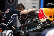 March 27, 2014 - Sepang, Malaysia. Malaysian Formula One Grand Prix. Red Bull Racing mechanics work on Vettel's engine.<br /> <br /> © Jamey Price / James Moy Photography