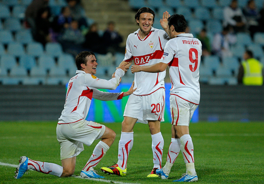 Stuttgart's Martin Harnik from Austria, left, reacts after scoring against Getafe with fellow team members Christian Gentner, center, and Ciprian Marica from Romania, right, during their group H Europa League soccer match at the Coliseum Alfonso Perez stadium in Getafe, near Madrid, Thursday, Nov. 4, 2010.