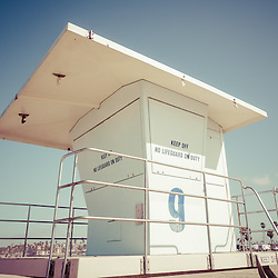 Retro photo of Huntington Beach lifeguard tower. Photo has 1950's / 1960's nostalic tone applied. Huntington Beach is a seaside beach city in Orange County Southern California and is also known as Surf City USA. Image Copyright © Paul Velgos All Rights Reserved.