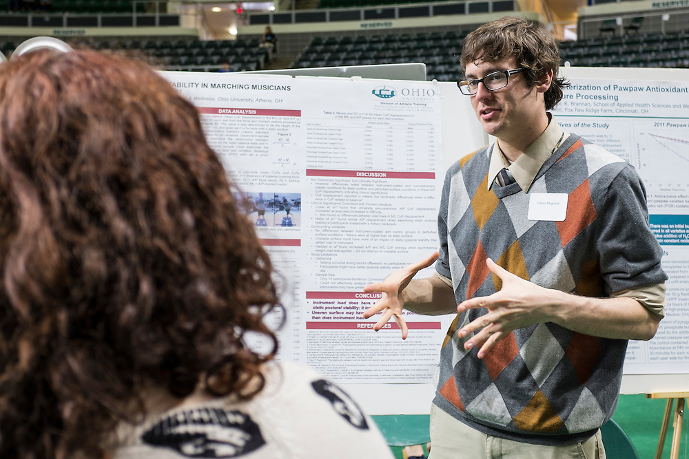 Ohio University graduate student Trevor Magnotti, right, explains his research on the posture of marching band participants during the 2015 Ohio University Research and Creative Activity Expo on Thursday, April 10, 2015.  Photo by Ohio University / Rob Hardin