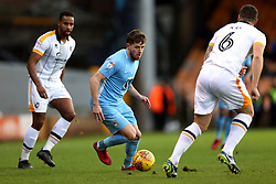 Coventry City's Marc McNulty (centre) takes on Port Vale's Antony Kay (right)
