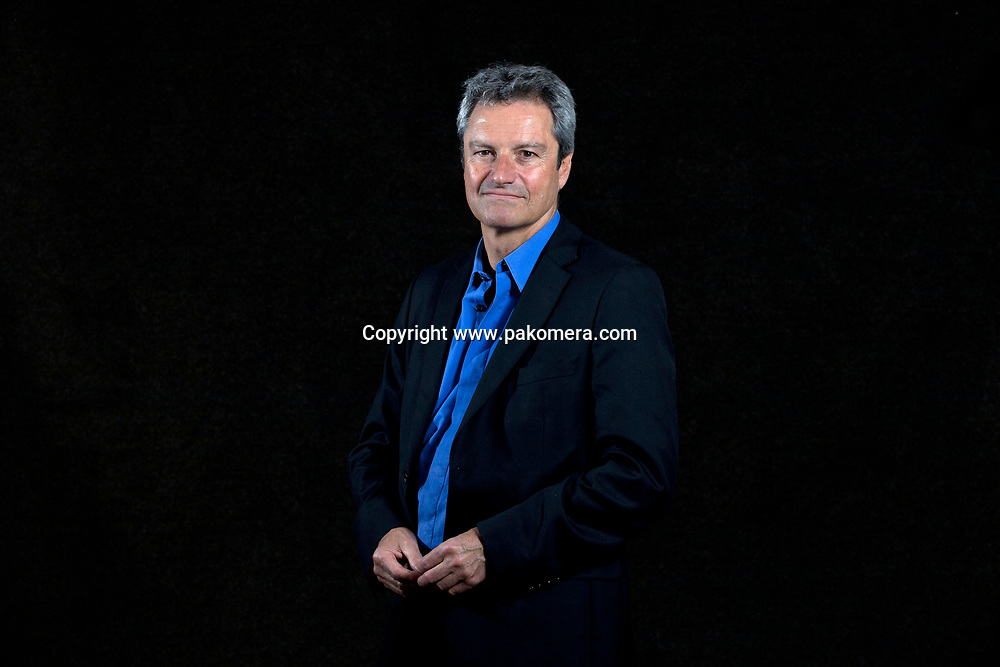 A portrait of Gavin Esler at the Edinburgh International Book Festival 2012 in Charlotte Square Gardens<br /> <br /> Pic by Pako Mera