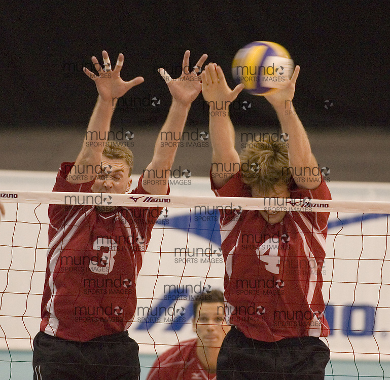 Michael Munday (3) and Chris Meehan (4) blocking as Tunisia defeats Canada three games to two in the 2006 Anton Furlani Volleyball Cup. .Copyright Sean Burges / Mundo Sport Images, 2006 .Anton Furlani Cup.Copyright Sean Burges / Mundo Sport Images, 2006