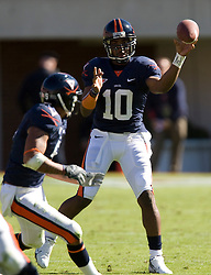 Virginia quarterback Jameel Sewell (10)  delivers a pass to Virginia tight end Mikell Simpson (5). The #23 Virginia Cavaliers defeated the #24 Wake Forest Demon Deacons 17-16 at Scott Stadium in Charlottesville, VA on November 3, 2007.
