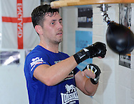 Picture by Alan Stanford/Focus Images Ltd +44 7915 056117<br /> 30/09/2013<br /> IBF World Middleweight Champion Darren Barker puts some work in on the speed ball during a media workout at Gator ABC, Hainault, Essex.