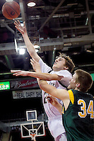 JEROME A. POLLOS/Press..Lake City's J.J. Stoddard goes up for a shot in front of Craig Spjute from Borah High during the first half of the T-Wolves 52-46 loss to the Lions at the state 5A boys basketball tournament Thursday at the Idaho Center in Nampa.