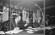 Alf Murray (Armagh) (right) President of GAA relaxes and shares a light with the Secretary of the GAA Sean O'Siochain, during a lull in the proceedings at the Annual Congress of the GAA held in the Gresham Hotel, Dublin on Easter Sunday...Annual Congress, GAA. 18.4.65. *** Local Caption *** It is important to note that under the COPYRIGHT AND RELATED RIGHTS ACT 2000 the copyright of these photographs are the property of the photographer and they cannot be copied, scanned, reproduced or electronically stored in any form whatsoever without the written permission of the photographer