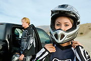 Motocross Racer Putting on Helmet