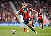 Bournemouth Defender Steve Cook (3) beats Chelsea Midfielder Cese Fabregas (4)' to the ball during the Barclays Premier League match between Bournemouth and Chelsea at the Goldsands Stadium, Bournemouth, England on 23 April 2016. Photo by Adam Rivers.