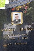 Cemetery in Radicofani, Italy (near Pienza) with photo on a gravestone.